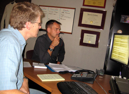 Mike Ziccardi and Hugo Nijkamp (right) plan the schedule for the upcoming EOW Conference