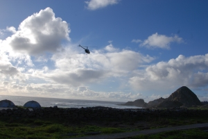 Helicopter flying over Southeast Farallon Island.