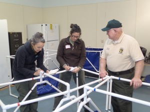 Staff and volunteers assembling net-bottomed pens at the MWCC