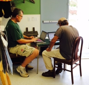 Mark Garman and Richard Grise create new accounts in the database during the Pacific Wildlife Care workshop last weekend.