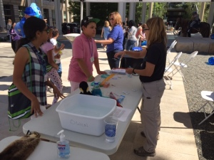 Nancy Anderson shows kids how to get started with feather experiment