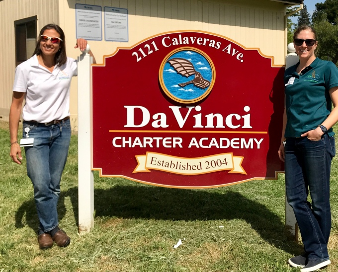 OWCN staff in front of Da Vinci sign