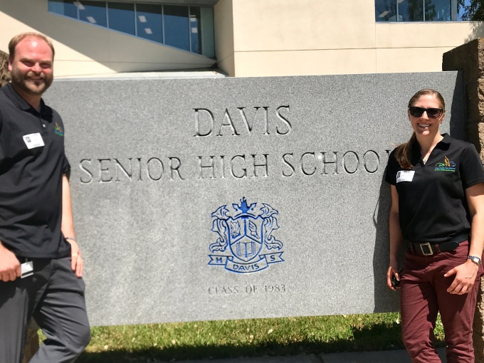 OWCN staff in front of Davis High School sign